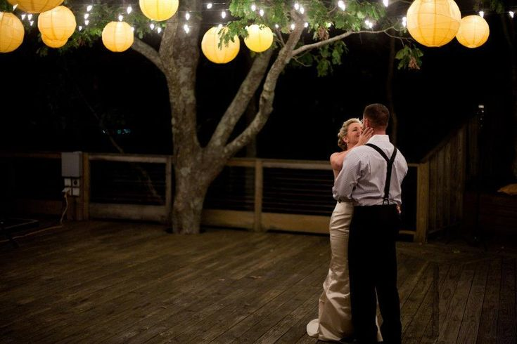 lanterns and string lights for a beautiful dance floor, from RusticWeddingChic.com