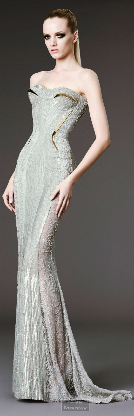 Atelier Versace. Not sure about the gold on the bodice. But I love the rest of the dress: