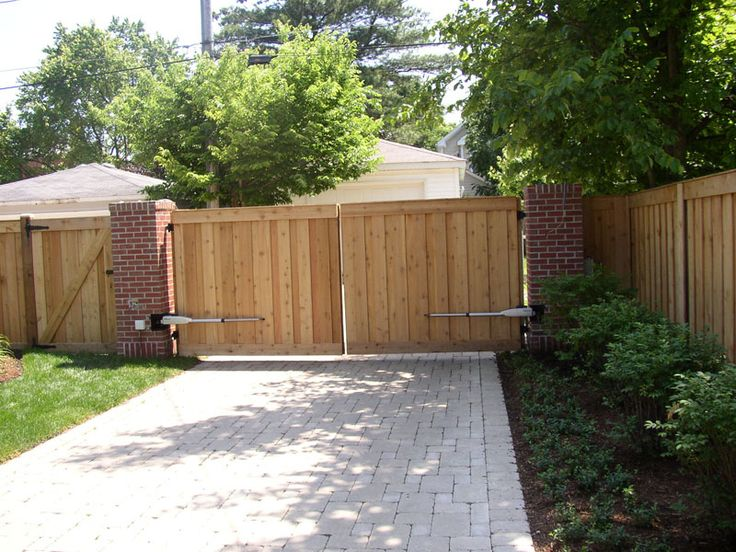 RusticFences.com | Wood Fencing Wood fence with electric gate opener