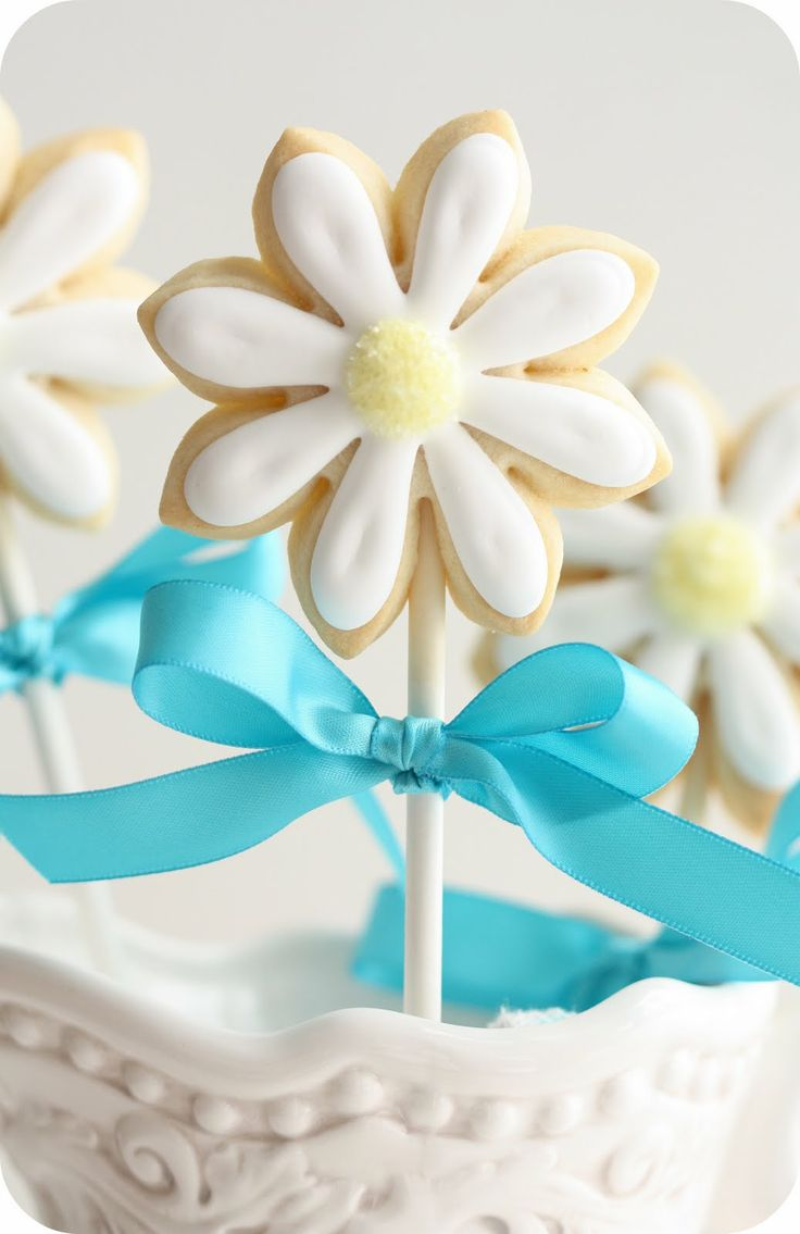 Making Cookie Pops.Cookies on a stick... a great way to make flower cookies, but any kind of cookie on a stick makes them more fun! Learn how to make cookie pops in this video: