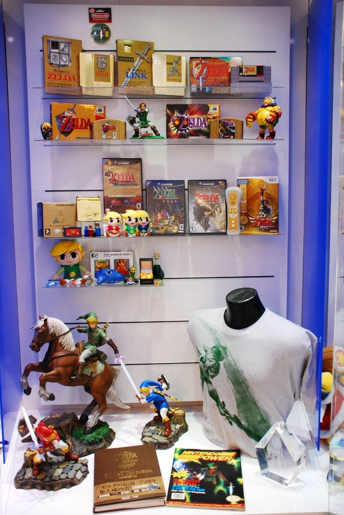 Legend of Zelda Franchise Cabinet at Nintendo World.... I want that big epona and link statue....