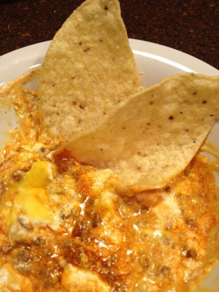 Taco dip: hamburger meat, taco seasoning, sour cream, and velveeta