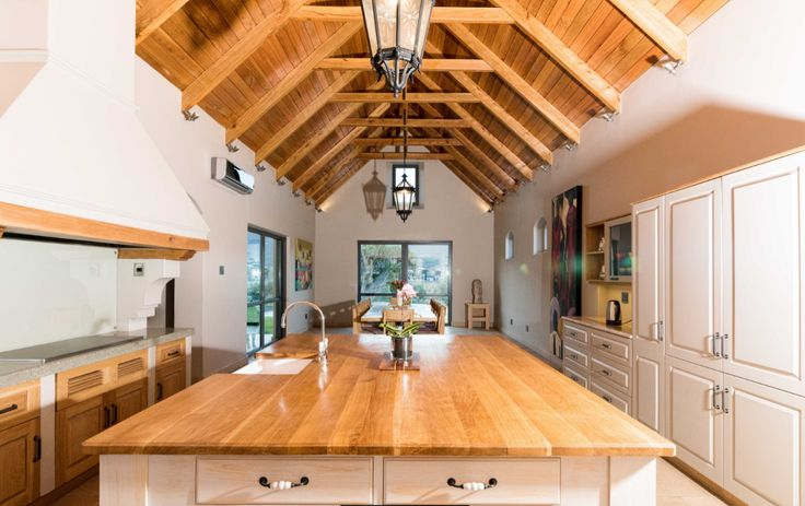 """The """"barn"""" area with the kitchen & dining room."""