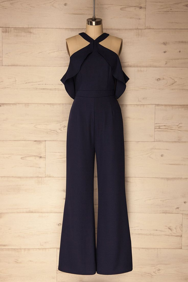Cantallops #Boutique1861 / This beautiful blue jumpsuit is well suited to every occasion. Its halter neck and slit down the back show off your skin, while the ruffles that fall gently over the bust add a little romance to the look. The pant legs are a slightly wider straight cut, so you'll feel comfortable and look fabulous all night long!
