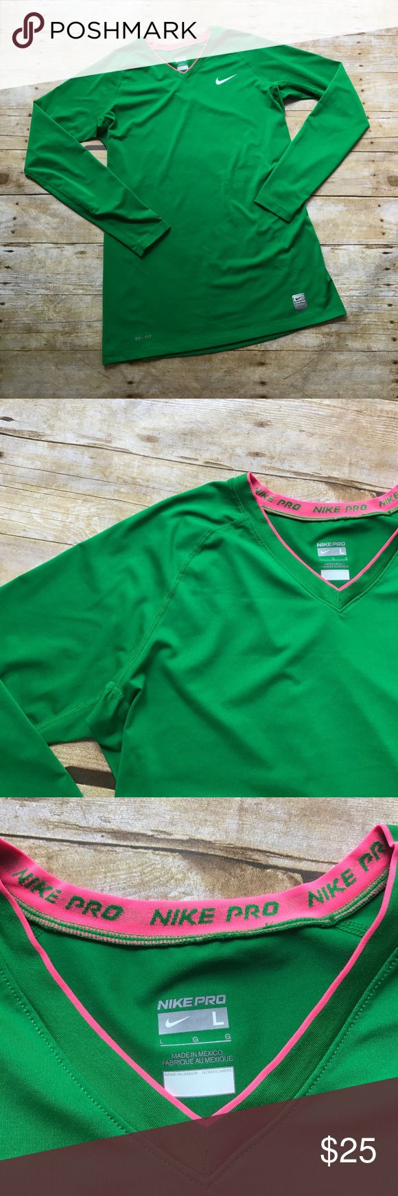 """Nike Pro Green Long Sleeve Top NWOT - Never worn! Nike Pro Kelly Green Long Sleeve Top with pink trim at collar. V neck. Dri fit material. Size Large. Measures approximately 16"""" across at bust, 28"""" from shoulder to hem. From a smoke free home! Nike Tops"""