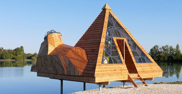 This pyramid-shaped cabin in France features beautiful stained glass windows and lookout towers.