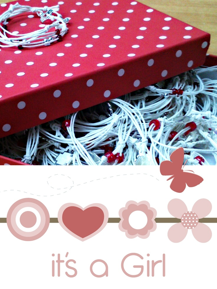 crusifixes for baptism in a red polka dots box
