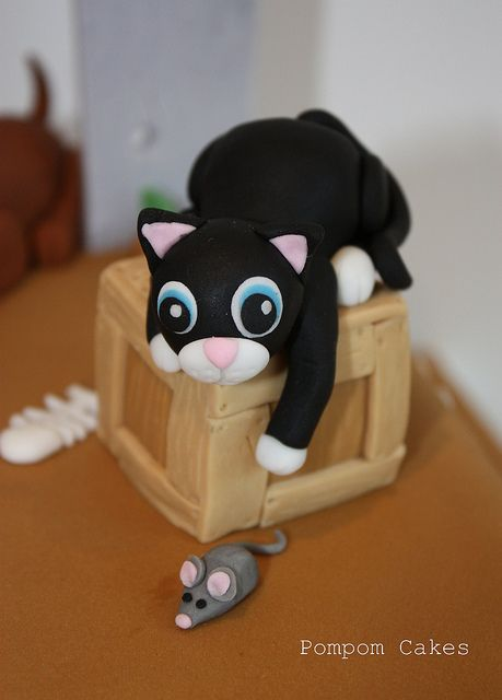 Black cat chasing mouse by Pompom Cakes, via Flickr