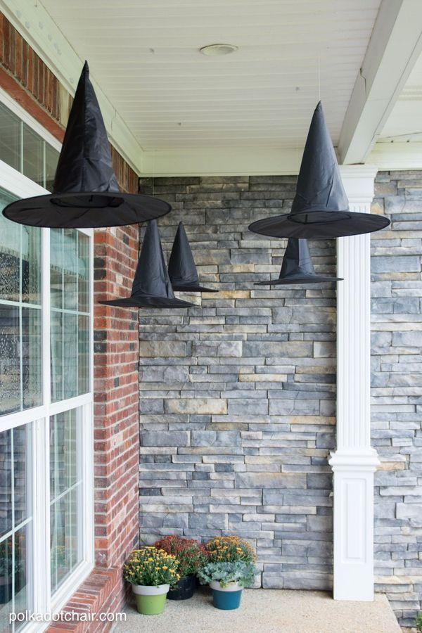 Clever decorating idea for a porch for Halloween: floating Witch's hat luminaries. Floating outside the entry to your house, this DIY crafts will add punch to your next carving party.