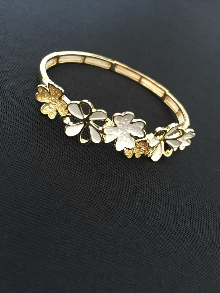 Unique Fashion Jewellery Australia - Gold and White Enamel Flowers Ikita Bracelet, $40.00 (http://www.uniquefashionjewellery.com/gold-and-white-enamel-flowers-ikita-bracelet/)