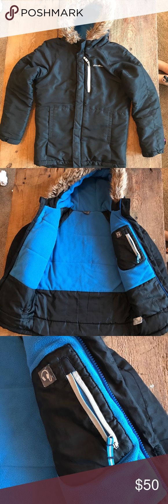Boys Eddie Bauer Parka size 10 Great condition! Worn for about a half season before he grew out of it. Very warm with lots of functionality. My son loved the headphone/iPod holder so he could listen to music while waiting for the bus in the morning. There is very little to no signs of wear and has been freshly laundered. There has been some small repair of loose seams by the pocket and underarm which is not noticeable. Eddie Bauer Jackets & Coats