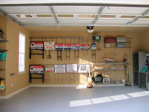 ELFA rails & brackets without shelves hold real estate signs.