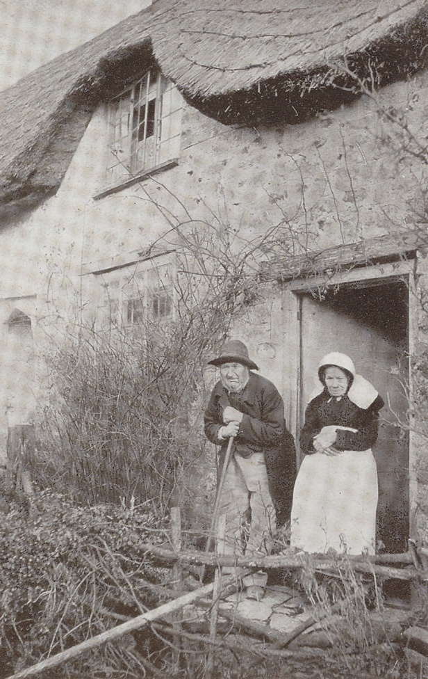 Photograph of elderly couple outside Beaminster cottage