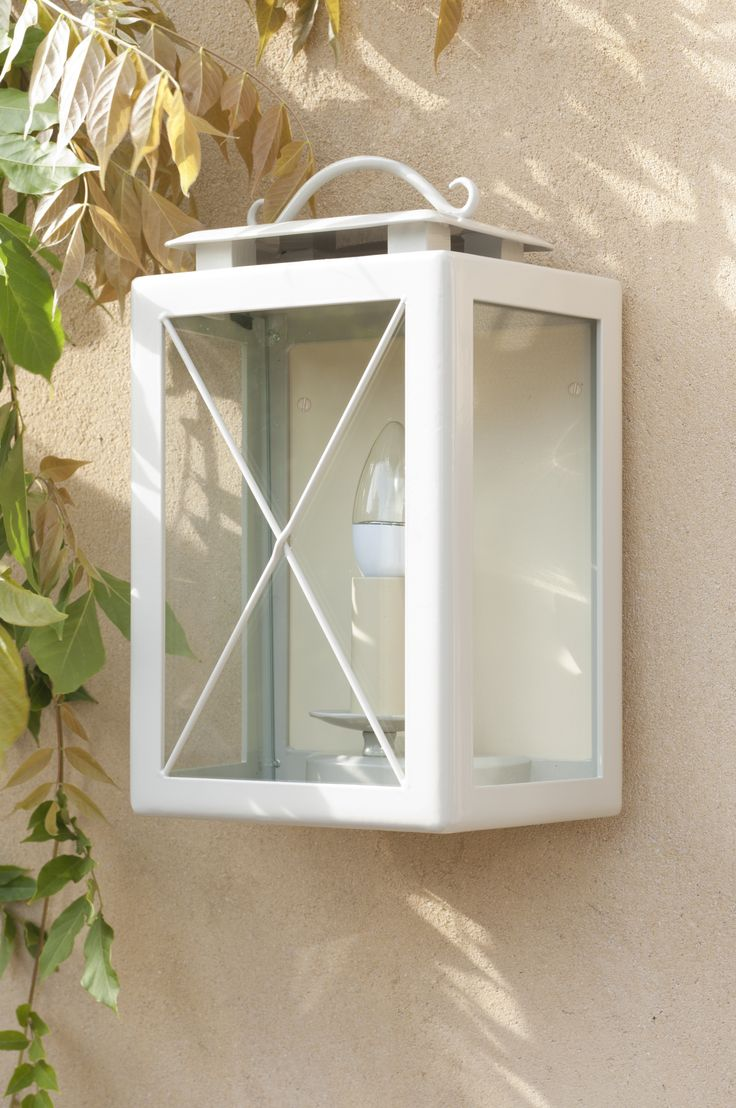 The Coach #Lantern in #Clay painted finish is a beautiful edition to any exterior.