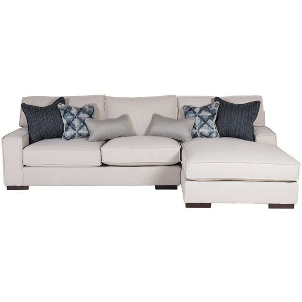 The Kendleton Stone Chair 2PC Sectional Sofa w/ RAF Chaise from the Kendleton Stone Collection by Ashley Furniture beautifully blends retro sensibility with contemporary taste. The stone-colored linen-look fabric and the flange welt along the seams create a crisp, designer feel, while the large chaise lounge and deep seating allow you to curl up and get comfortable.