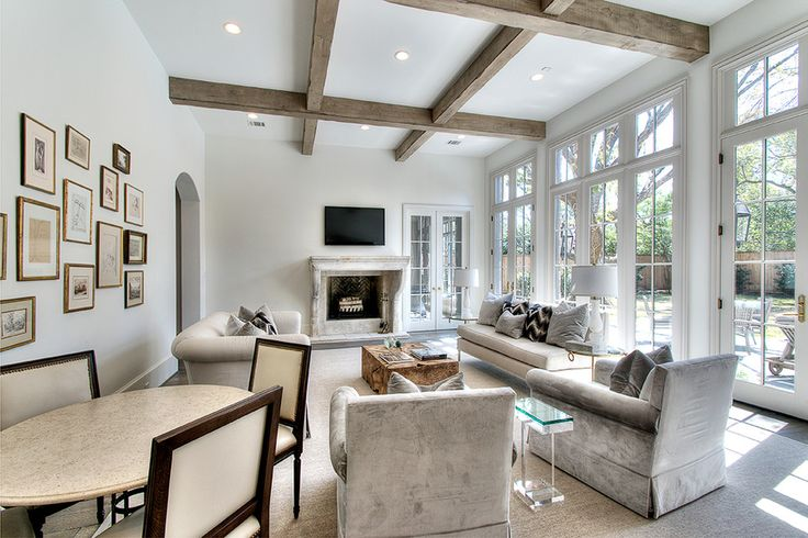 Exposed wood beam ceiling family room transitional with recessed lighting exposed beams