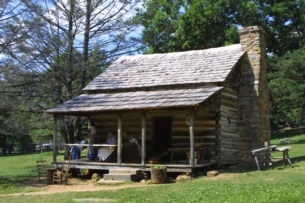 The neighbors up the hill lived in a log cabin very much like this one.