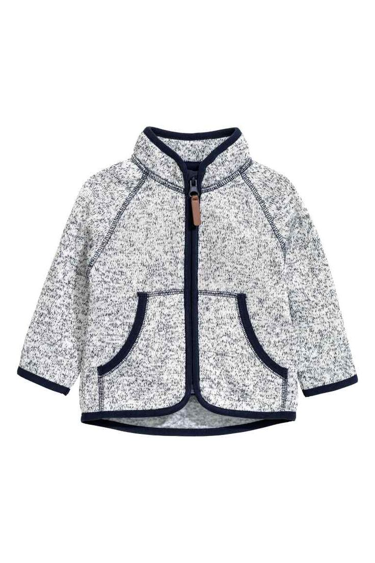 Knitted fleece jacket: Knitted jacket in soft, thermal fleece with a stand-up collar, zip down the front and front pockets.