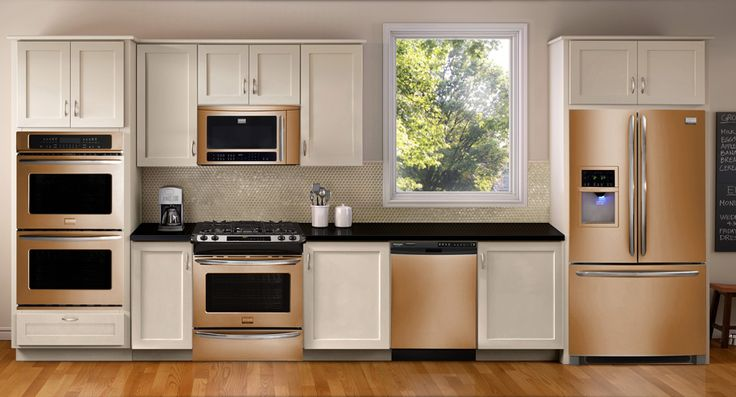 Lighting is really important for the Whirlpool Sunset Bronze finish; it can look more copper or champagne in different lightings. Here there aren't as many windows in the kitchen, so the shadows show the appliances to be a deeper copper shade.
