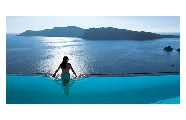 Perivolas Luxury Hotel, Santorini Not surprisingly, the pool, which appears to flow over the edge of the cliff into caldera's bay 300 metres below, has been featured on numerous magazine covers.