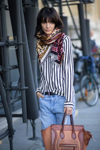 Play up vertical stripes with a printed scarf: