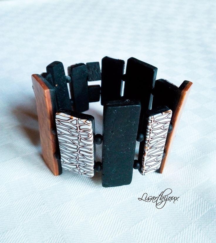 Bracelet en pâte polymère, noir, blanc doré sur élastique : Bracelet par lisartbijoux