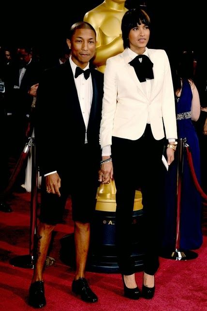 Pharrell Williams y su esposa.  http://cuchurutu.blogspot.com.es/2014/03/ellos-y-parejas-en-oscars2014.html