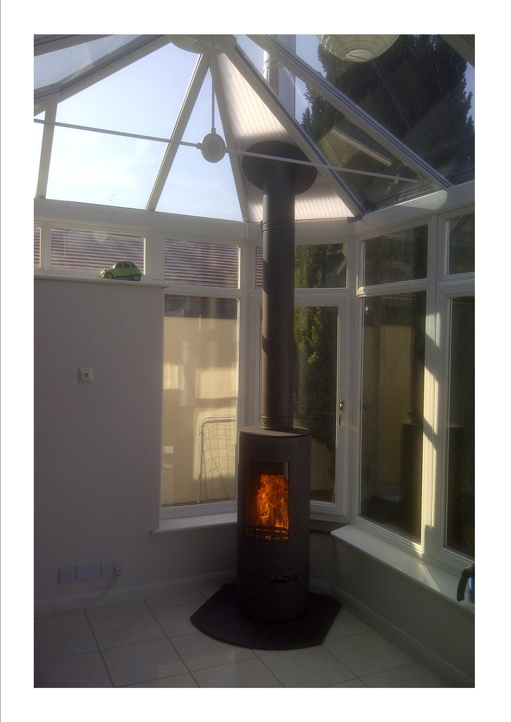 Wood burner in a conservatory setting.