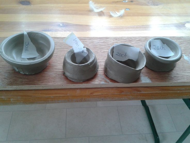 just off the potter's wheel! small pots by Zach, Jodii and Rhianna (we stick paper labels on with their names and when dry, the pots can be initialled properly)