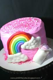 Adorable newborn cake, cute pink with rainbow.