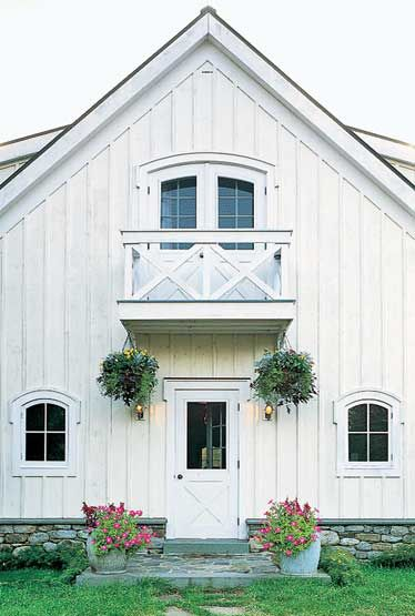 White barn-inpsired house, would be neat as a garage and apartment above!