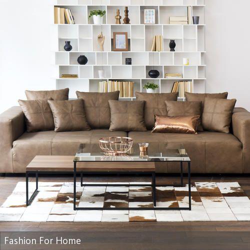 Eine echte Ruheoase. Zum Entspannen und Genießen lädt das tiefe Sofa Basso ein. Das weiche Leder und das warme Braun ergänzen das Couchtisch-Set aus Glas und …