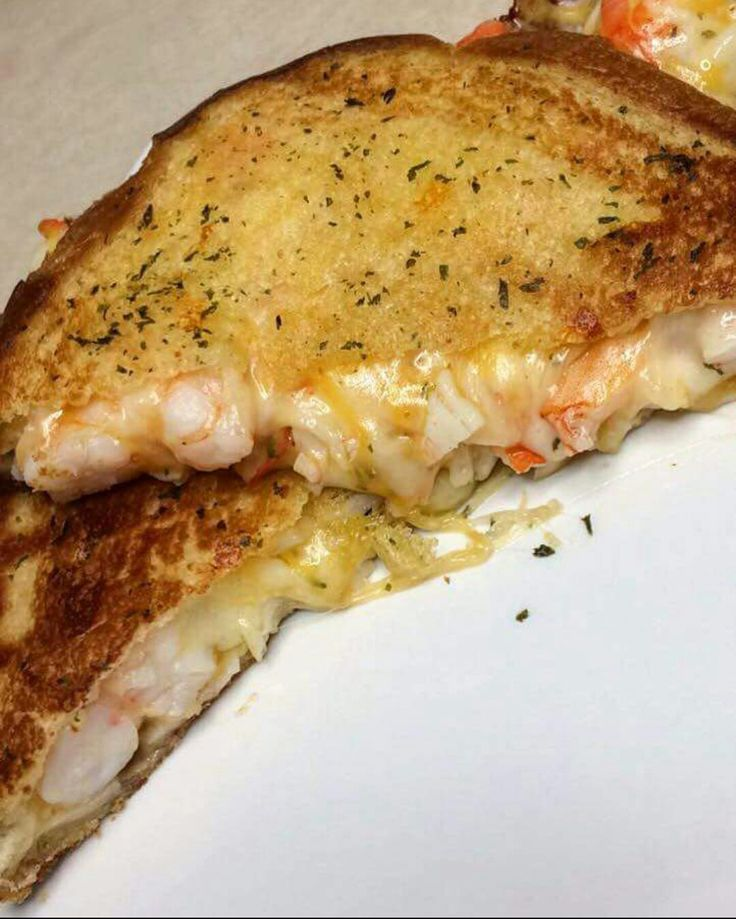 Tried something new today and when I tell you, it was soo freaky good. My dinner for today! Shrimp and crabmeat grill cheese with homemade garlic bread!  Here's the recipe  1 lb of large shrimp I believe 1/2 or 3/4 lb of imitations crab meat ( you can also use real crab meat, I would prefer!!! Didn't have none at the time so I used what I can) 3 minces garlic cloves  2 slice of bread 2 Tbs of butter  1 tsp of olive oil  4 slice of provolone cheese and shredded cheese   Instructions  Preheat…