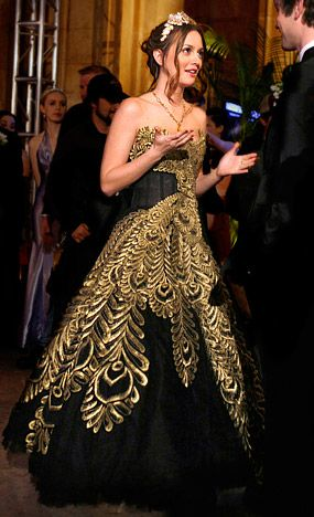 If only every girl was so lucky to wear a one-of-a-kind Marchesa Black Feather Gown to her senior prom...