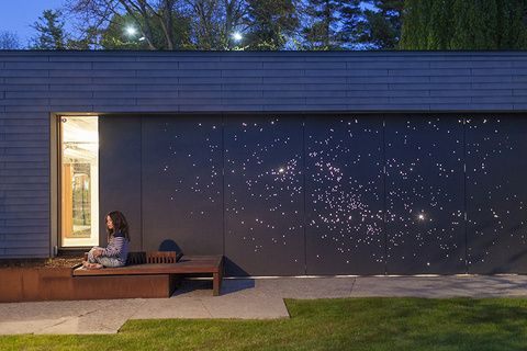 A celestial light installation illuminates the garage door of a recently renovated Toronto house.  project: Don River House