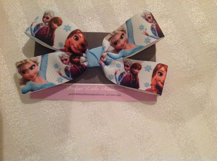 Frozen hair bow. Great addition to loot bags. Can be attached to a clip or hair elastic. All clips are lined with no-slip grip. Contact us for yours today: perfectlittleadditions@yahoo.ca. Find us on Facebook: facebook.com/perfectlittleadditions.
