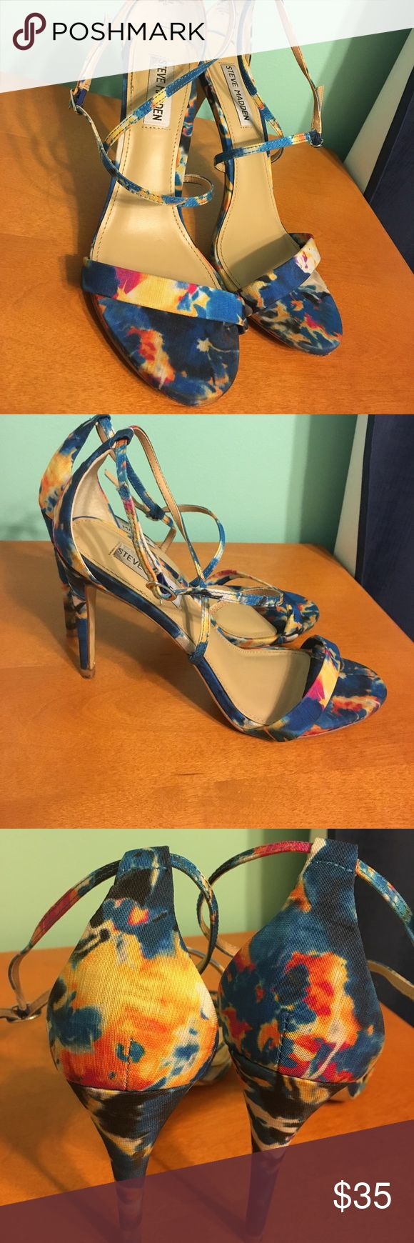 Steven Madden Strappy Floral Heels-8.5 Good condition! Worn once to a wedding. Steven Madden Floral Blue, yellow, pink, orange, and white strappy heels. Size 8.5!! Very comfortable and in good condition. Steve Madden Shoes Heels