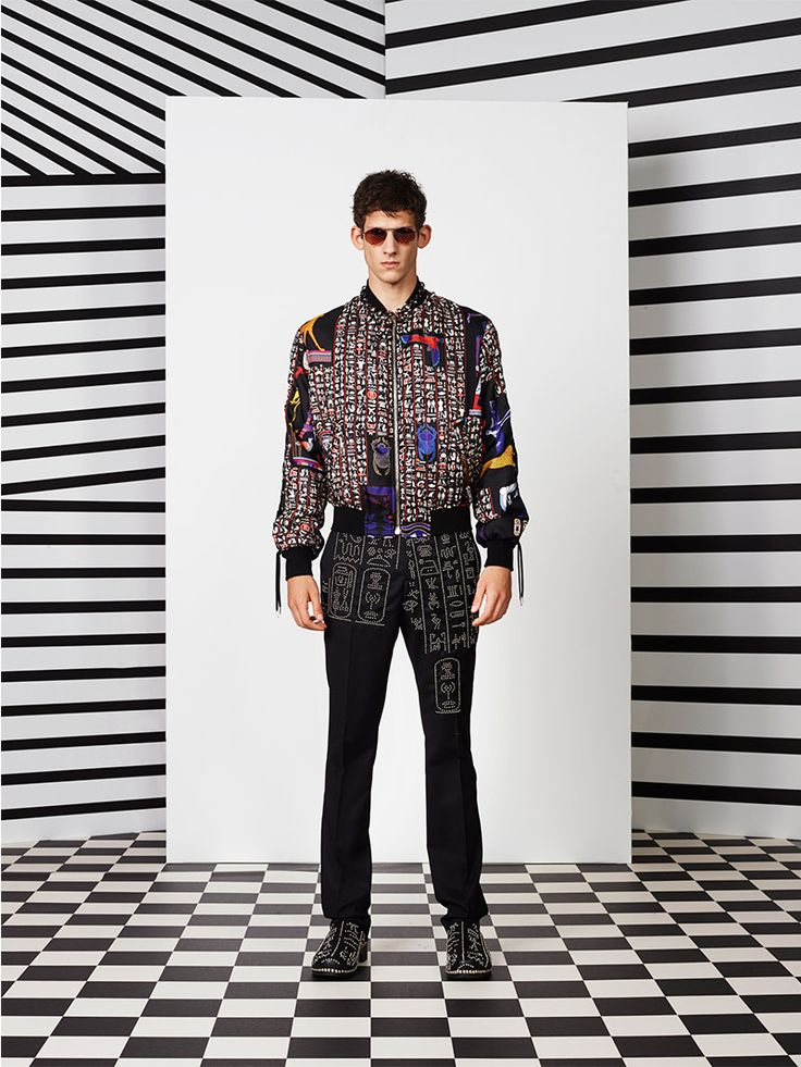 """This summer, the Jean Paul Gaultier Men collection celebrates the 90's. Juxtaposition of strong colors plays a graphical game. Block colors are clashing in a bold attitude with the sophistication of the lace –"""" trompe l'œil """" polka... »"""