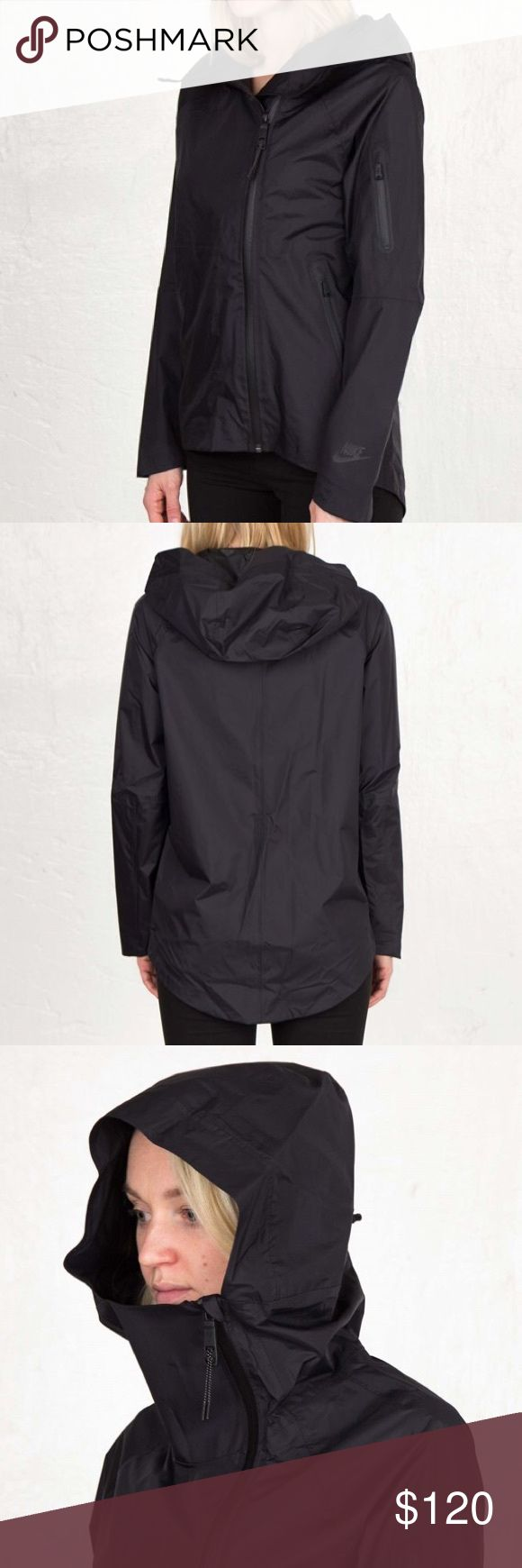 Nike H20 Woven Women's Cape Jacket Waterproof NO TRADES - The Nike H20 Woven Women's Cape. Waterproof nylon fabric helps keep you dry in the rain. Oversized scuba hood adjusts for custom coverage. Interior media pocket and headphone tunnel. Drop-tail hem for enhanced coverage. Asymmetrical front-zip closure for easy on and off. Hook-and-loop closure at cuffs for a customizable fit. Bonded zip pockets on sides and left sleeve Fabric: Shell: 100% nylon. Body: 70% cotton/30% polyester. Pocket…