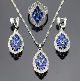 Products that inspire: Blue Sapphire White Topaz Surrounded 925 Sterling ...