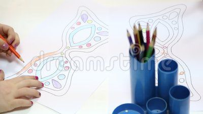 Preschoolers drawing at kindergarten - girl and boy draw with crayons.