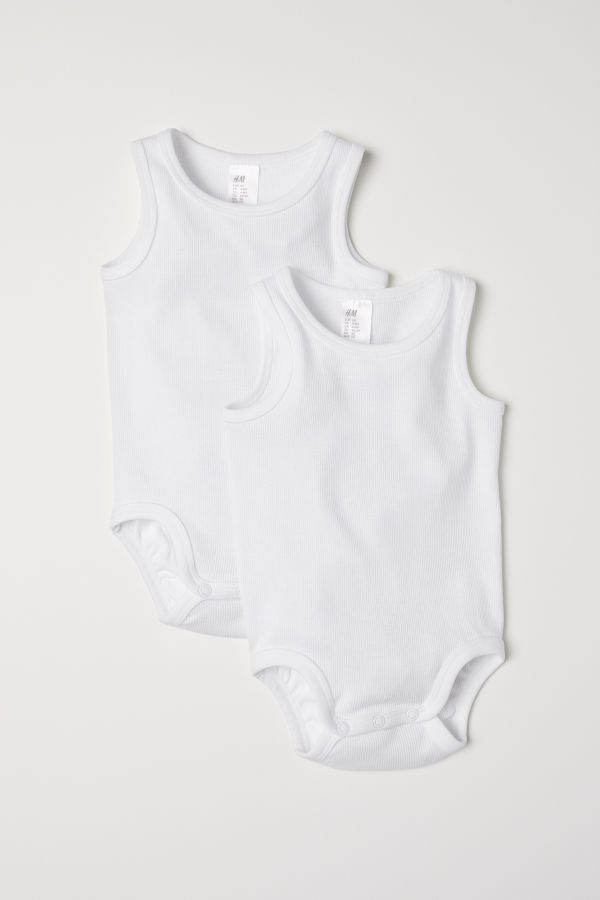 06c75ae690b Sleeveless bodysuits in ribbed organic cotton jersey with press-studs at  the crotch. - Visit hm.com to see more.