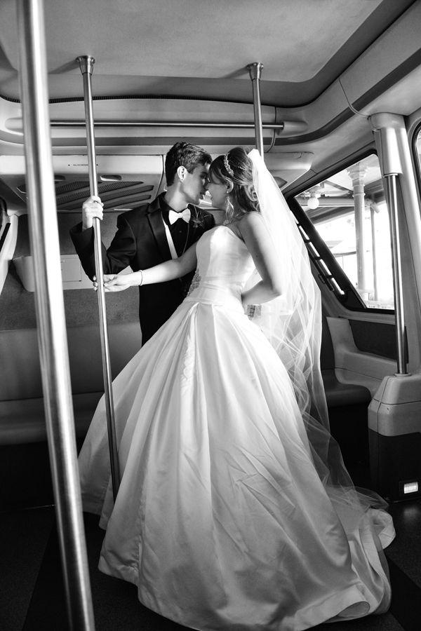 Bride and groom on the monorail. Walt Disney World Wedding Photos: Tara + Matthew. See more photos at http://magicaldayweddings.com/walt-disney-world-wedding-photos-tara-matthew/