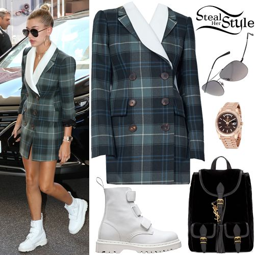Hailey Baldwin arrived at Martinez Hotel in France wearing Alessandra Rich Fall 2017 Ready To Wear (Not available yet), her Saint Laurent Velour Festival Backpack (Sold Out), a Rolex Day-Date 40 Oyster Perpetual Watch ($34,400.00), Gucci Metal Aviator Sunglasses ($159.20) and Dr. Martens Coralia Velcro-Strap Boots ($80.00+).