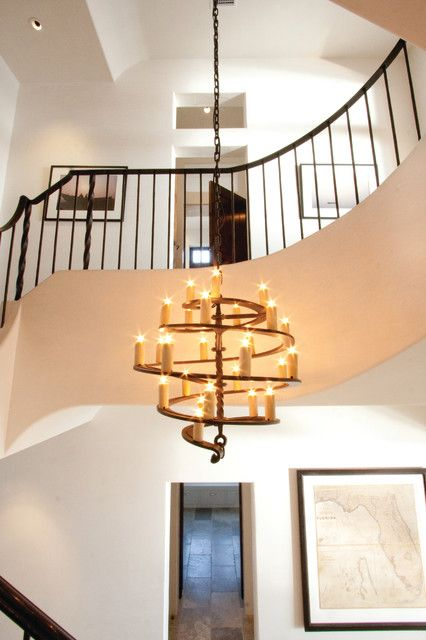 Tropical Spiral Chandelier Installed With Chain On Ceiling Center Of Two Floor Home Stairwell