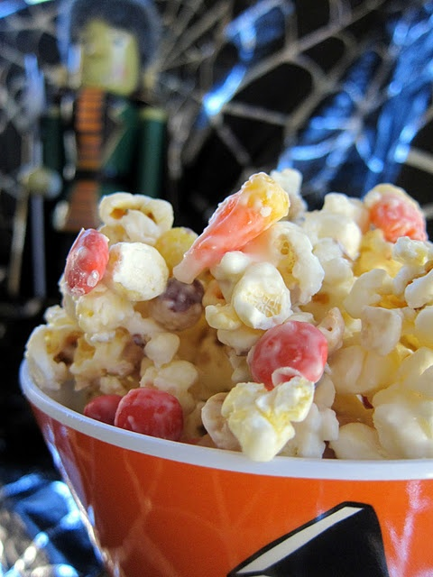 Monster Munch.....microwave popcorn then add Reese Pieces, peanuts, and candy corn. Melt almond bark, pour over mixture, and stir. Sounds mouth watering!!!