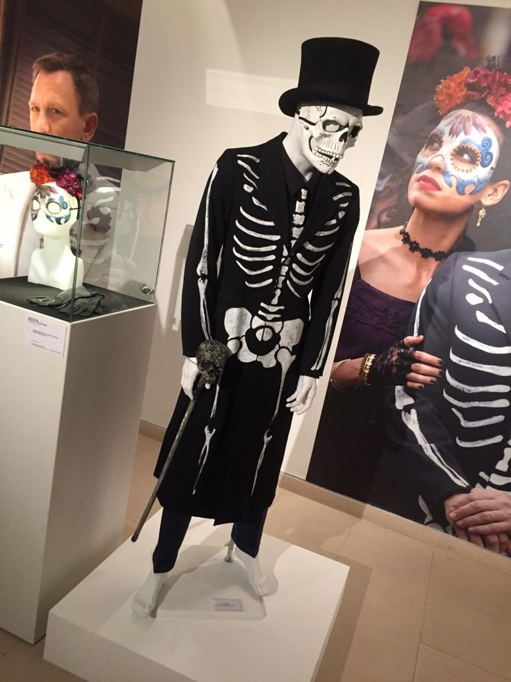 James Bond's Day of the Dead Costume worn by Daniel Craig. Black frock coat with white hand painted bones & skull mask.
