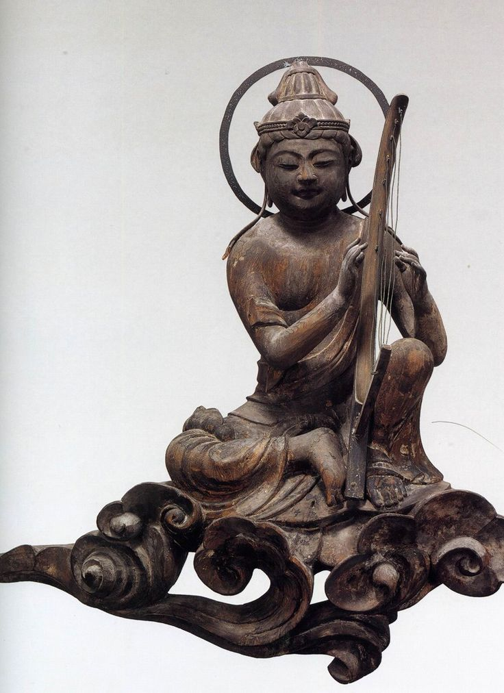 Bodhisattva playing. ca 1053. Byodoin Temple - Kyoto, Japan.