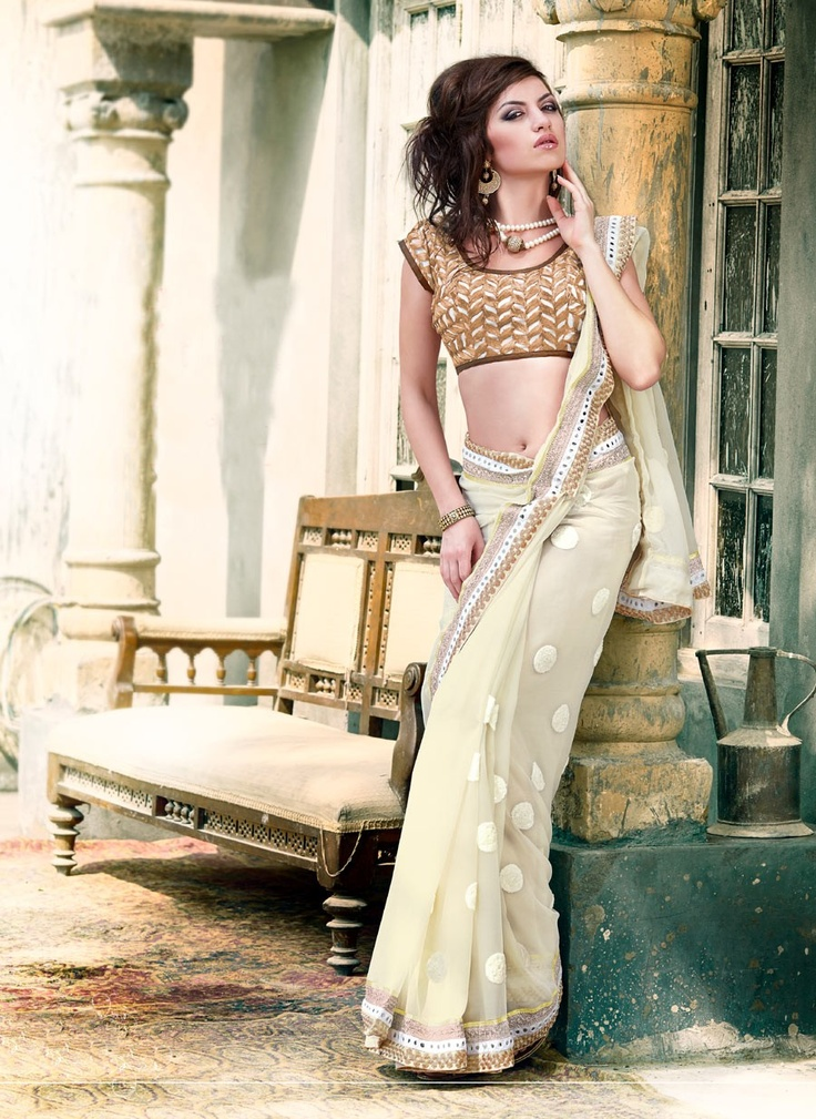 Splendorous Buttercream Embroidered Saree  http://www.gravity-fashion.com/9229-splendorous-buttercream-embroidered-saree.html    Item Code: VI35493    Color: Buttercream  Fabric: Faux Georgette  Work: Lace,  Mirror,  Resham    US$136.79