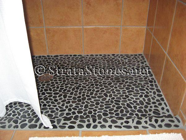 Google Image Result for http://www.stratastones.net/images/gallery/polished-black-pebble-tile-shower-floor.jpg